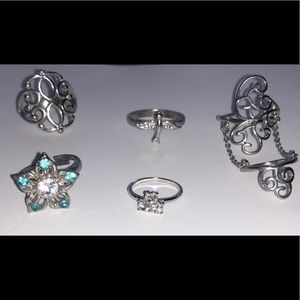 Lot of silver size 7 rings and midi rings